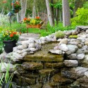 backyard-waterfall-with-flower , 11 Awesome Backyard Waterfalls Ideas In Apartment Category