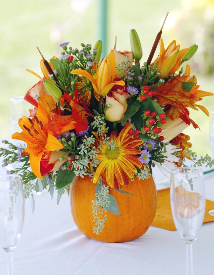 Lightning , 12 Amazing Pumpkin Centerpieces : pumpkin flower centerpieces with glass