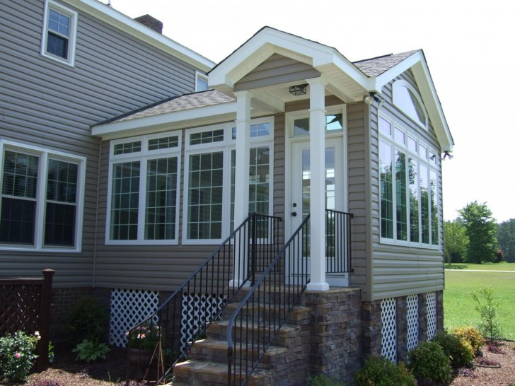 Sun room 5 good sunroom additions for Two story sunroom additions